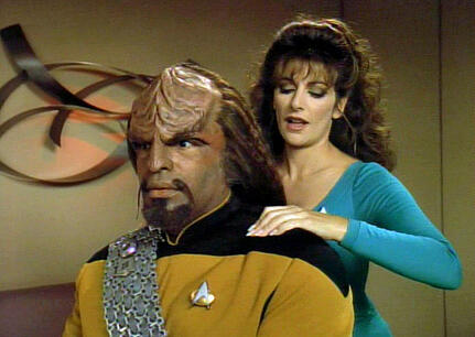 Deanna Troi and Warf make an uneasy couple
